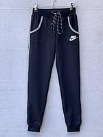 Спортивные штаны для девочки 7-10 лет синего цвета Nike оптом