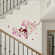 Вінілова наклейка на стіну Мавпа і рожева квітка дерево