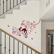 Виниловая наклейка на стену Обезьяна и розовый цветок дерево