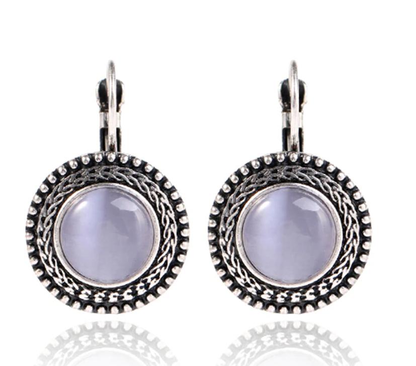 Сріблясті жіночі сережки з бузковим камінням код 1467