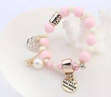 Женский браслет с розовыми бусинками
