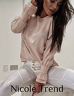 Женская блуза с воланами на манжетах