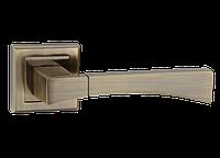 Ручка дверная нажимная Tia Z-1257 цинковая на квадратной розетке, фото 1