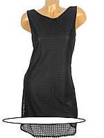 Прямого и свободного силуэта женское платье-сарафан Размеры: 42, 44, 46, 48 без рукавов. Выполнено из красиво