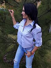 Блуза з кишенями в клітку