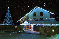 Световая иллюминация фасадов, украшение фасада гирляндами, подсветка дома на новый год