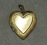 Медальон сердце. на 2 фото.