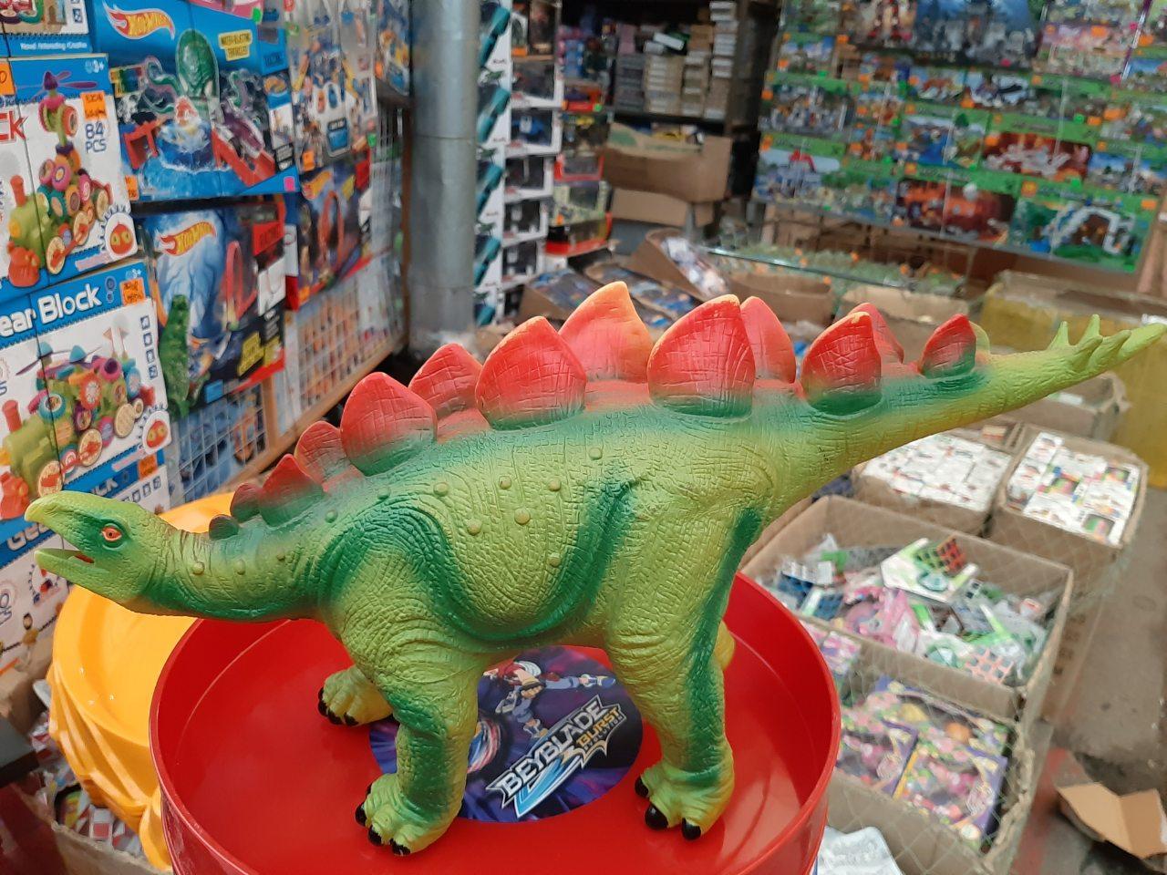 Динозавр музыкальный на батарейках 66002