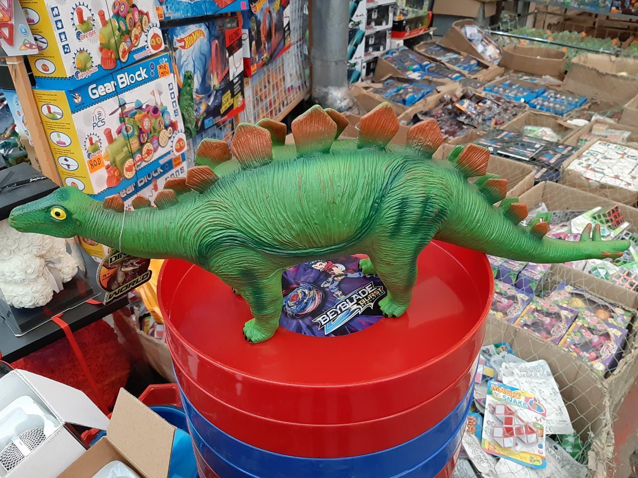 Динозавр музыкальный на батарейках 66003