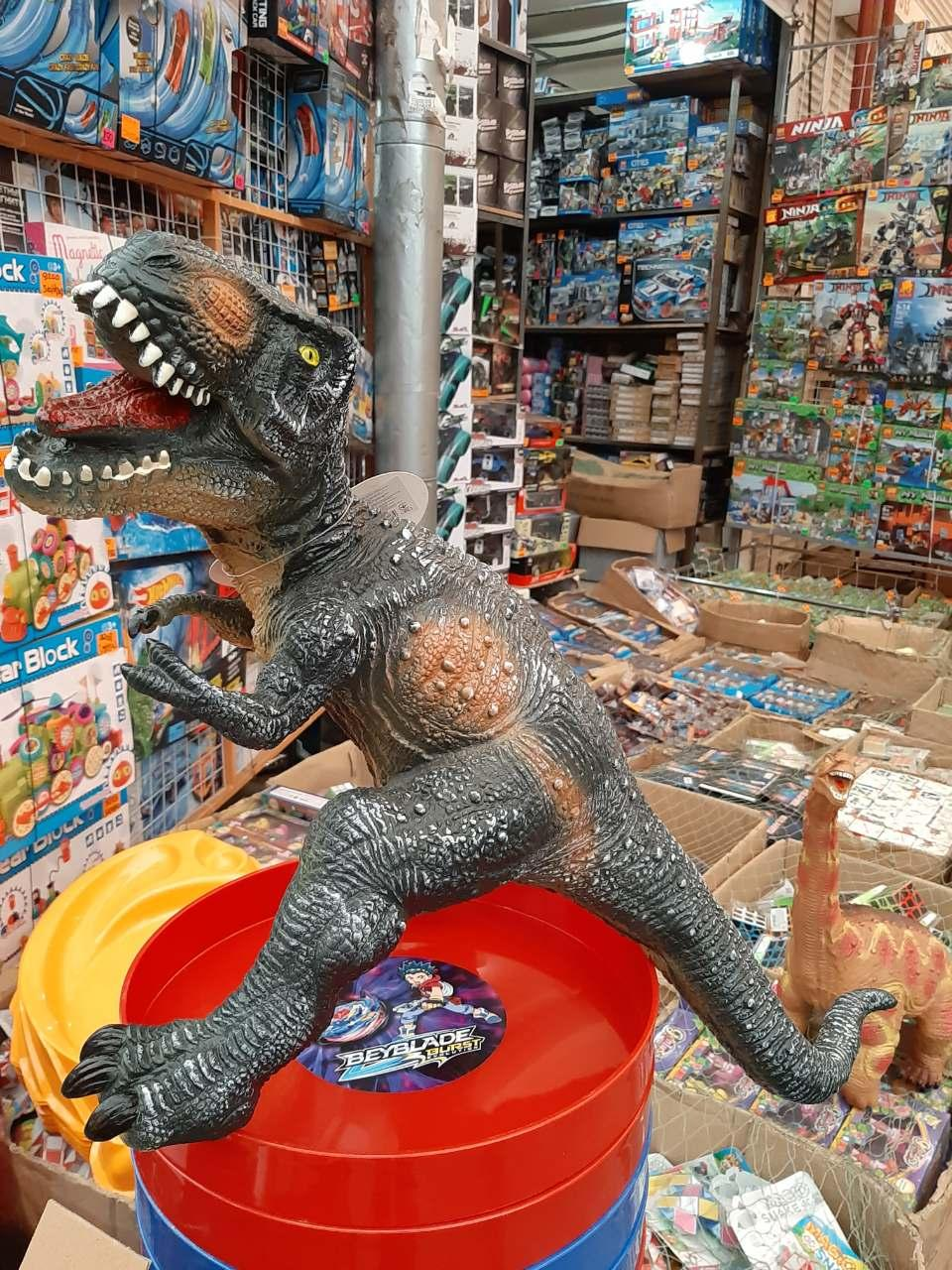 Резиновый динозавр музыкальный 359-32