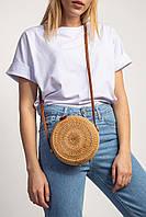 Плетёная маленькая сумка круглой формы