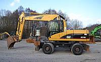 Колёсный экскаватор Caterpillar М318с 2006 года, фото 1