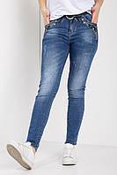 Стрейчевые джинсы батальные с потертостями и украшением