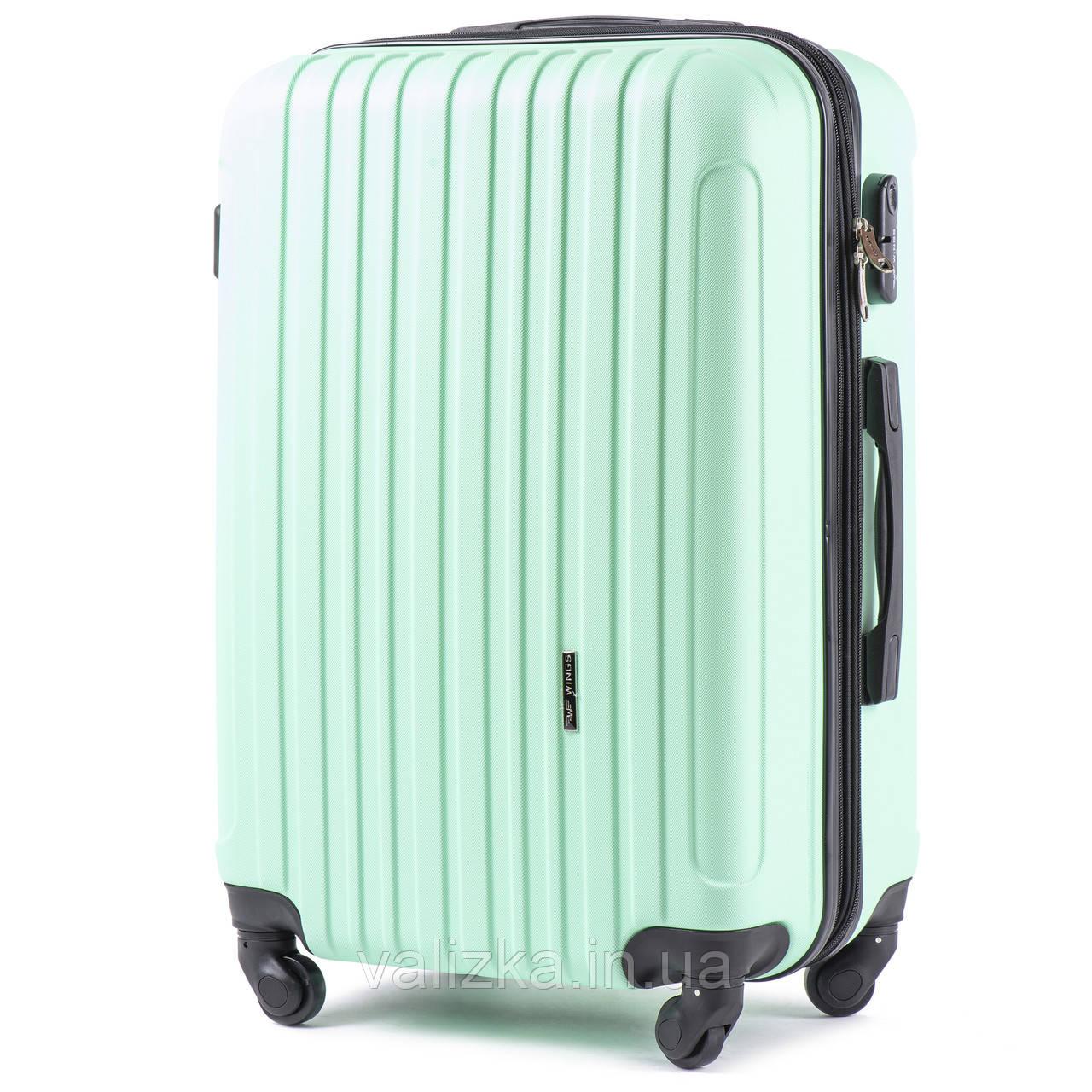 Великий пластиковий чемодан з полікарбонату з розширювачем Wings 2011 світло-зелений на 4-х колесах
