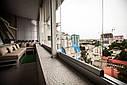 Безрамное остекление балконов и лоджий, фото 9