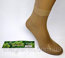 Капроновые носочки с тормозами бежевого цвета.