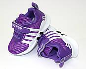 Красивые сиреневые кроссовки из текстиля