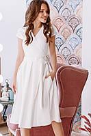 Стильное женское платье миди ниже колена белое