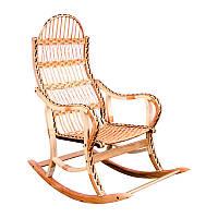Кресло-качалка, плетеная из лозы.
