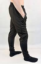 Брюки спортивные мужские трикотажные под манжет с молниями на карманах, фото 3