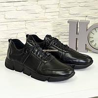 Кроссовки мужские из натуральной кожи черного цвета, на шнуровке.