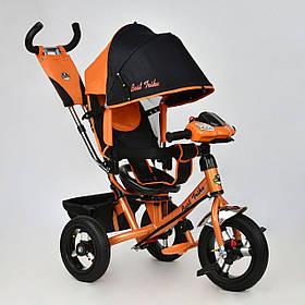Детский трехколесный велосипед Best Trike 7700 B-6010 поворотное сиденье, надувные колеса, фара, оранжевый