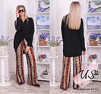 Женский молодежный трикотажный брючный костюм с леопардовыми штанами.