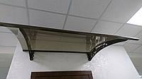 Защитный козырек над крыльцом из монолитного поликарбоната, цена за м2
