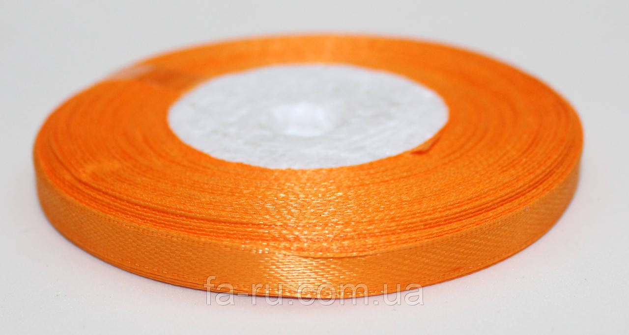 Лента атласная. Цвет - оранжевый. Ширина - 0,7 см, длина - 23 м