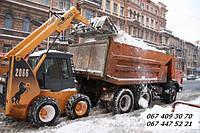 Вывоз снега в Киеве.