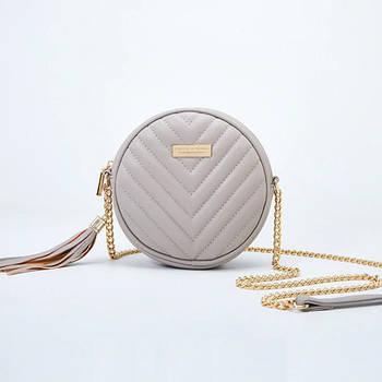 Модная маленькая женская сумка. Сумка женская круглая с кисточкой (серая)