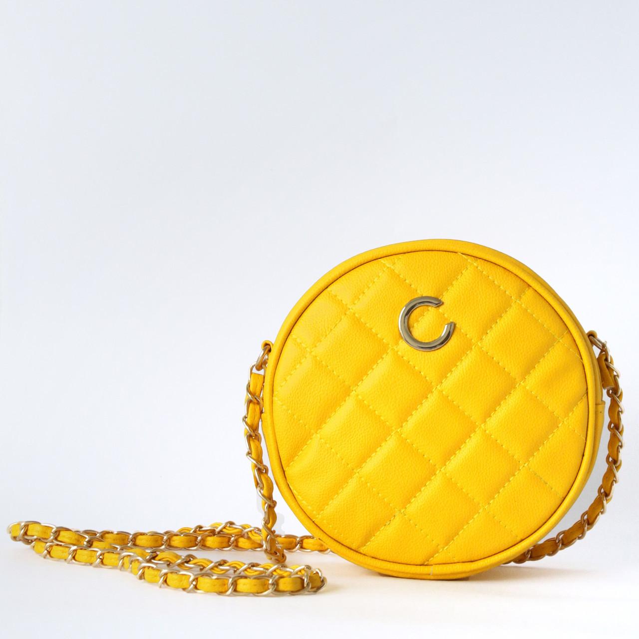 Желтая круглая сумочка из стеганой экокожи