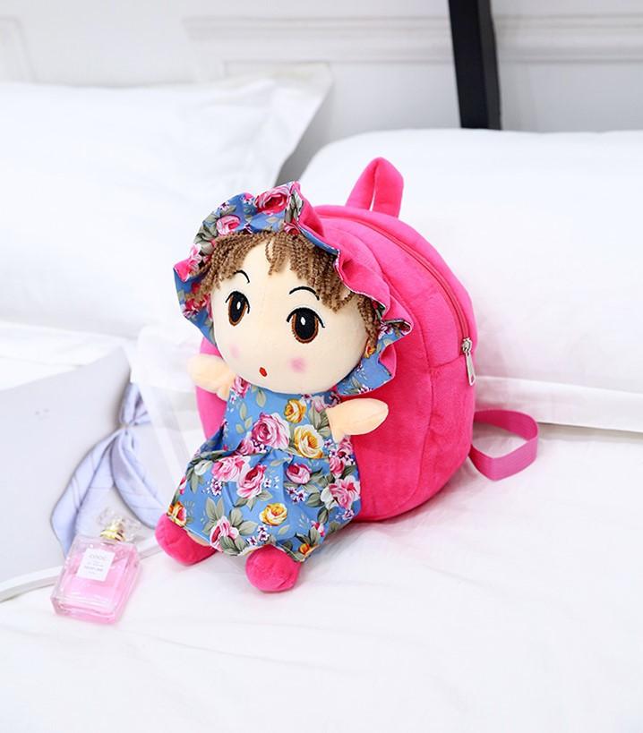 Маленький рюкзак для девочки с куклой розового цвета