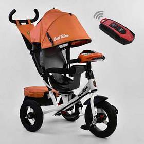 Дитячий триколісний велосипед з пультом Best Trike 7700 B 6090 поворотне сидіння, надувні колеса
