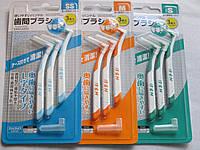 Зубная щетка для чистки межзубного пространства.