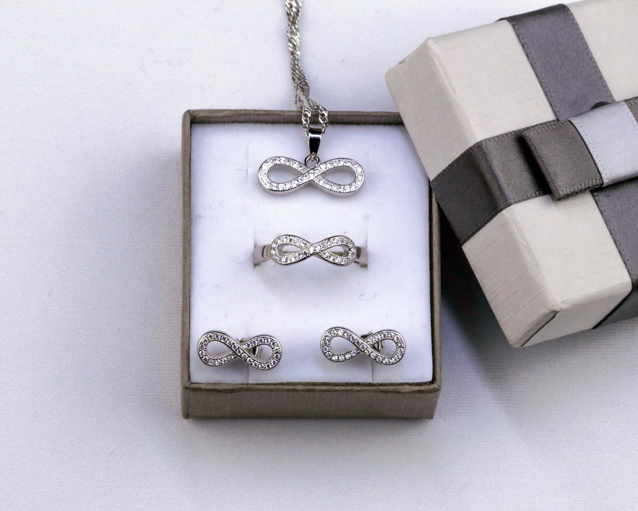 Комплект серебряных украшений Бесконечность с фианитами серьги, кулон, кольцо, цепочка