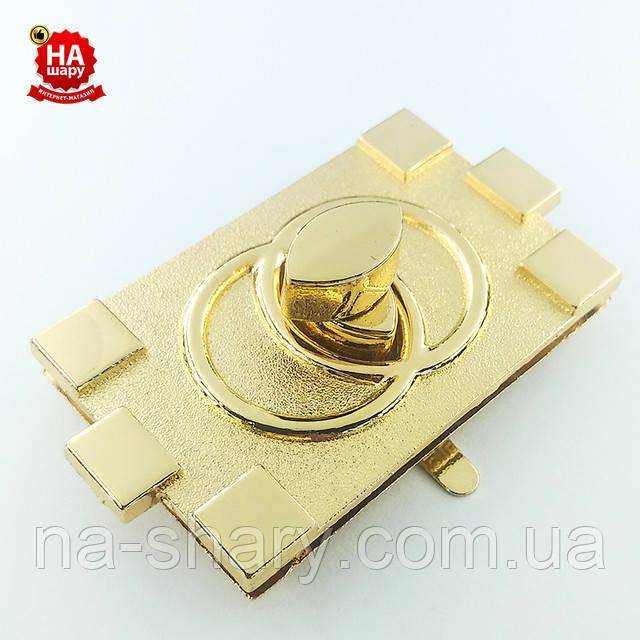 Замок поворотный золото