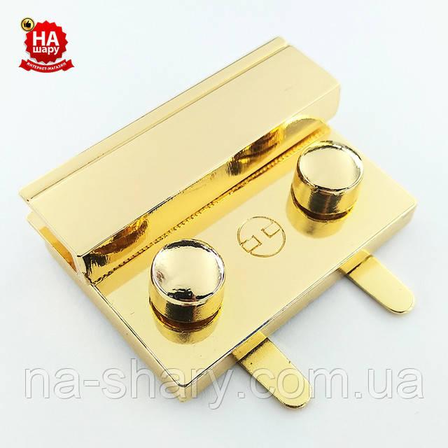 Замок на сумку 43 * 30 мм золотистый