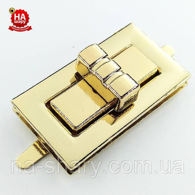 Замок на сумку 33 * 21 мм золотистый