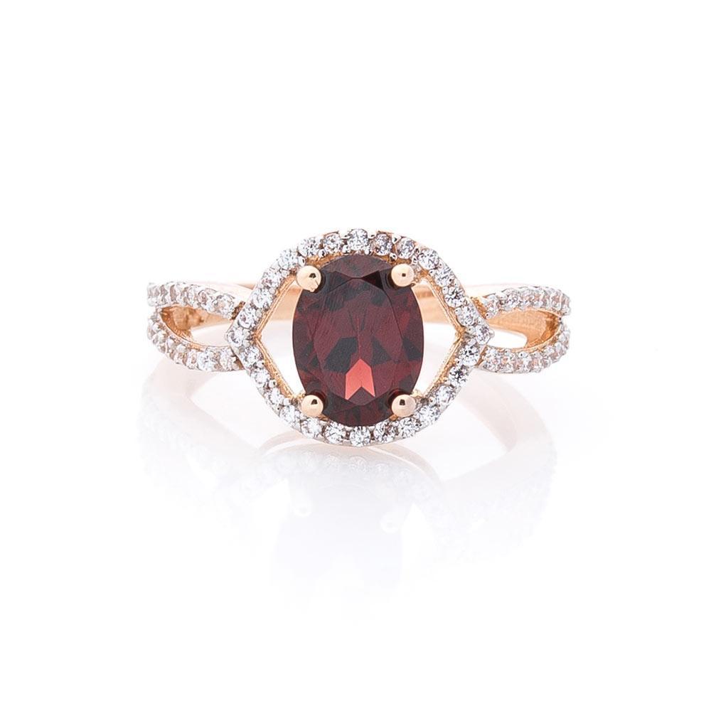 Золотое кольцо с пиропом (гранатом) и фианитами гк04655