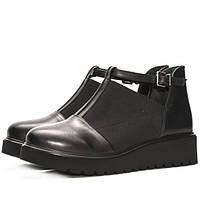 Аккуратная повседневная модель кожаных полуботинок. Вставки из резинки придают обуви свой неповторимый стиль.