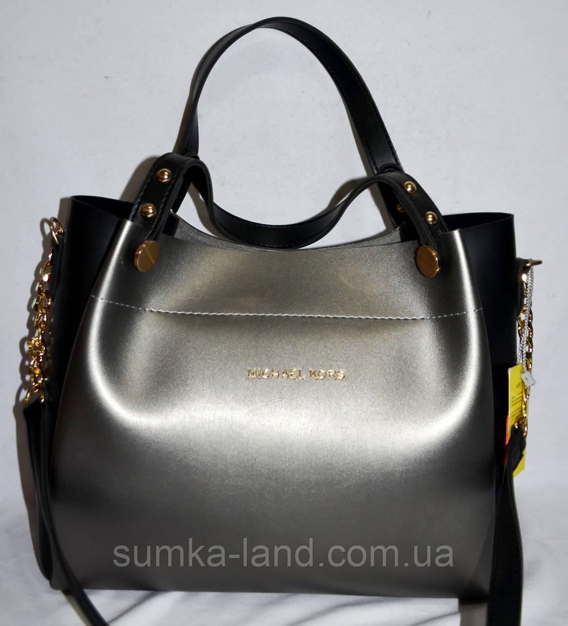 Женская серебристая с черным сумка Michael Kors с золотой фурнитурой и болтами на ручке 32*27 см
