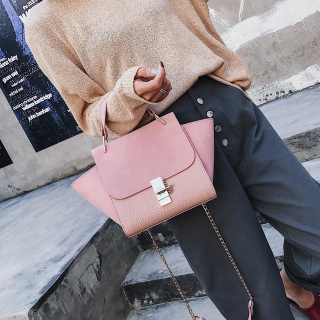 рожева сумочка