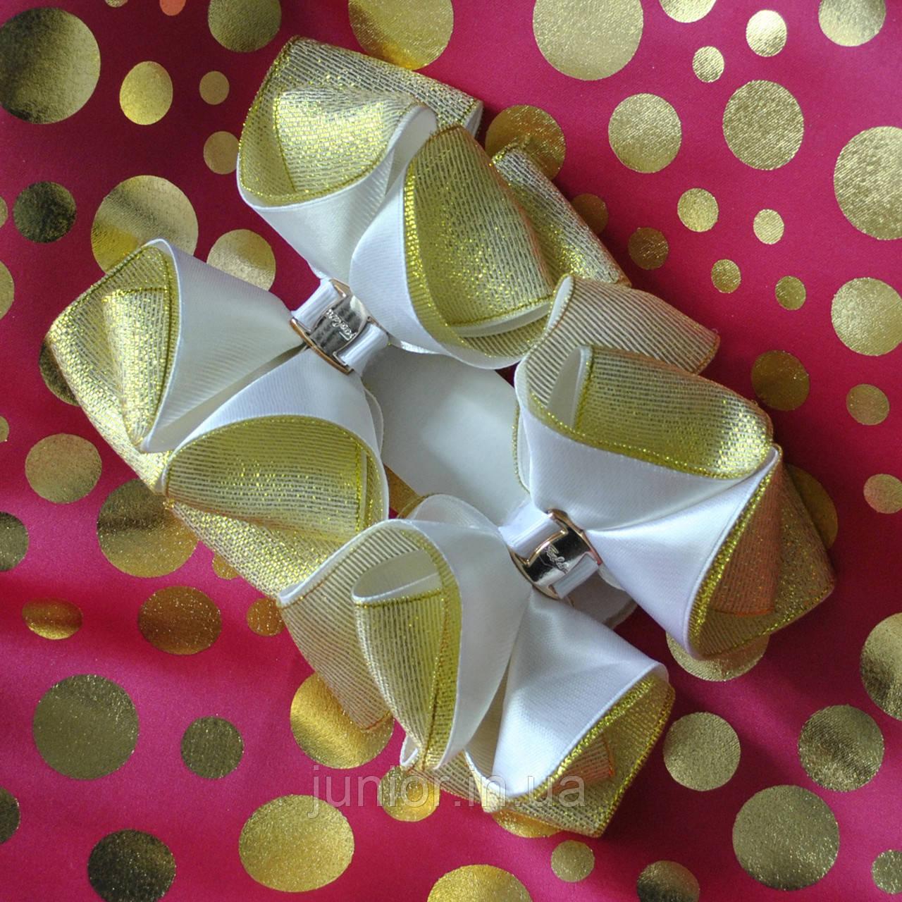 Золоті бантики на гумці для дівчинки.