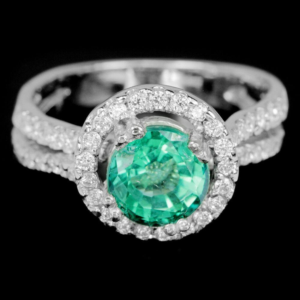 Серебряное Кольцо с натуральным зеленым Топазом и фианитами