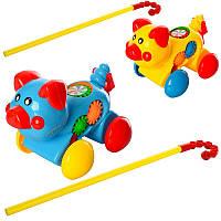 Каталка 0379 собачка, на палиці, шестерінки, 2 кольори, в кульку, 20-16-15 см