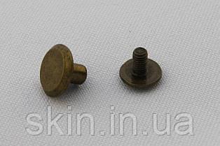 Винт ременной, диаметр шляпки - 10 мм, высота - 5 мм, диаметр ножки - 4 мм, цвет - антик, арт. СК 5040