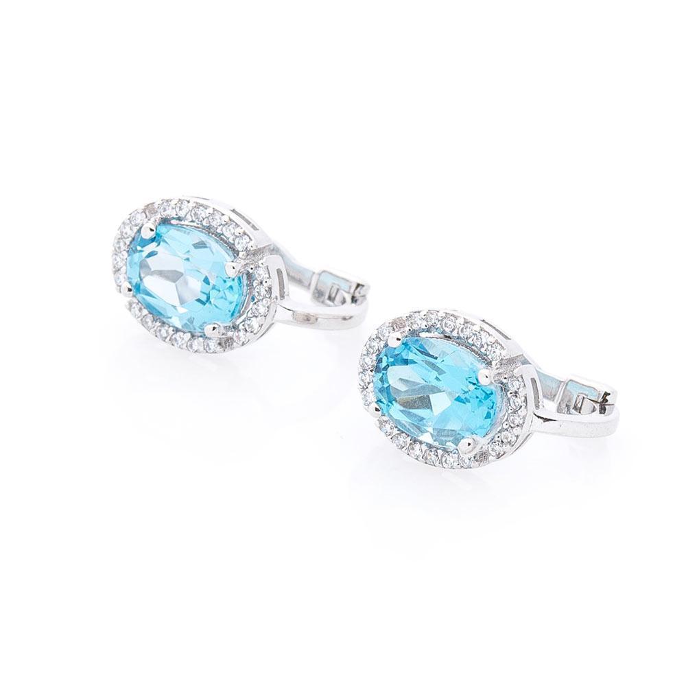 Золоті сережки з блакитним топазом і фіанітами гс04682