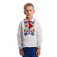 Белая вышитая рубашка вышиванка для мальчика с богатой яркой вышивкой