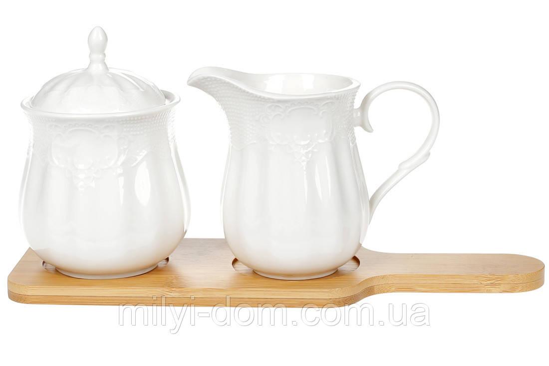 Набор фарфоровый:сахарница и молочник  на подставке